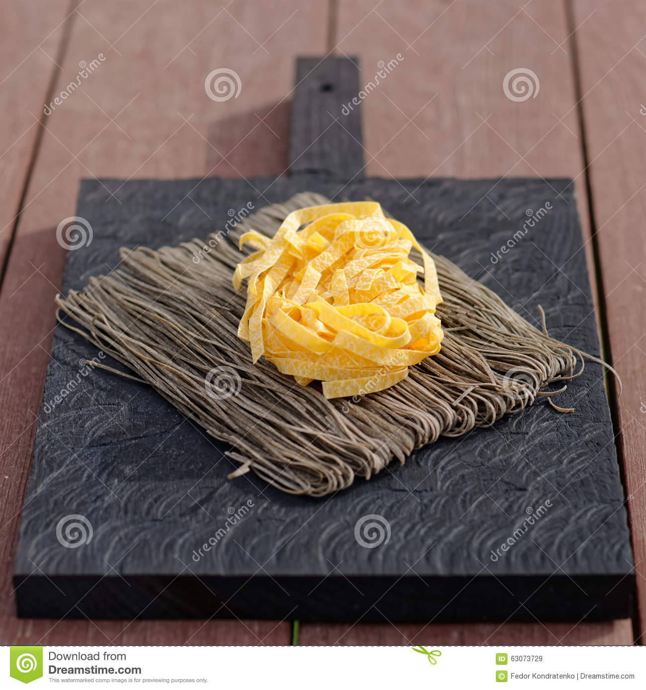 Different Types Of Cutting Boards Two Types Of Pasta On Old Cutting Board Stock Photo