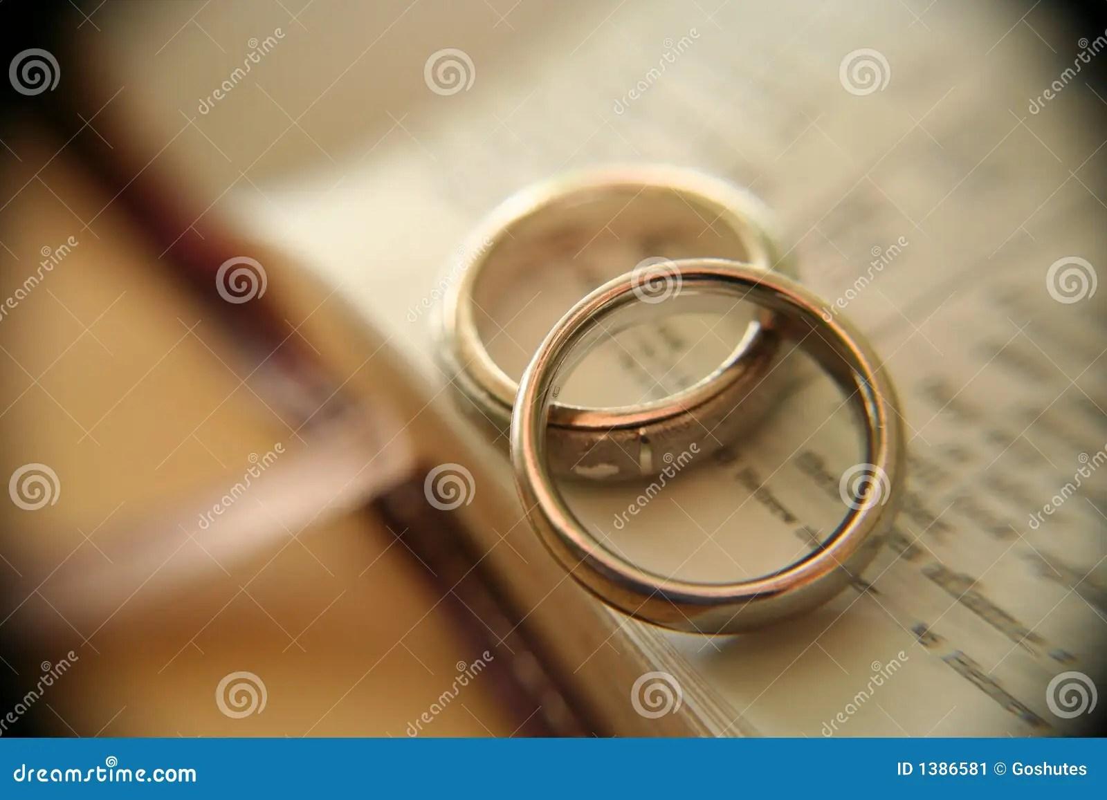 stock image white gold wedding rings bible image gold wedding rings White gold wedding rings on bible