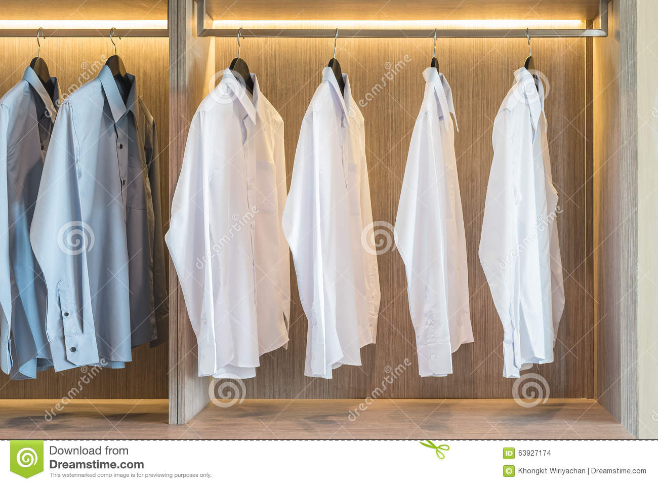 Grey And White Wardrobe White And Grey Shirts Hanging In Wardrobe Stock Photo