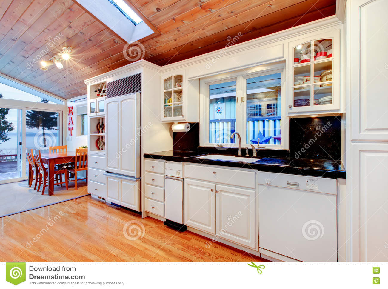 White Kitchen Cabinets With Black Counter Tops In Luxury House Stock Image Image Of Hardwood Stool 75361541