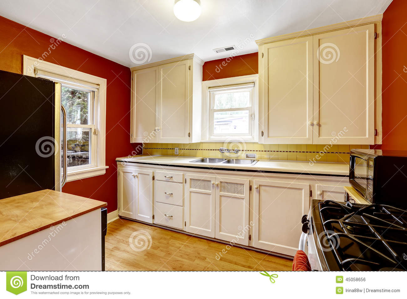 Bright Kitchen Cabinets White Kitchen Cabinets With Bright Red Wall Stock Photo