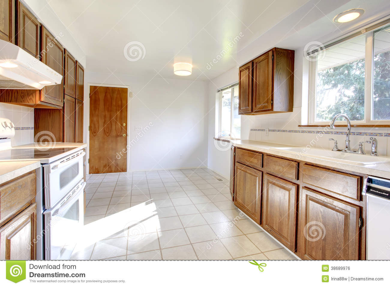 White Floor White Cabinets White Kitchen Room With Brown Cabinets Royalty Free Stock