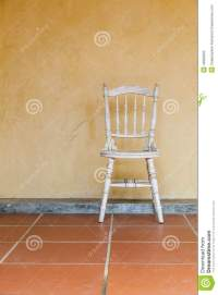 White Vintage Chair Near Yellow Old Wall Stock Photo ...
