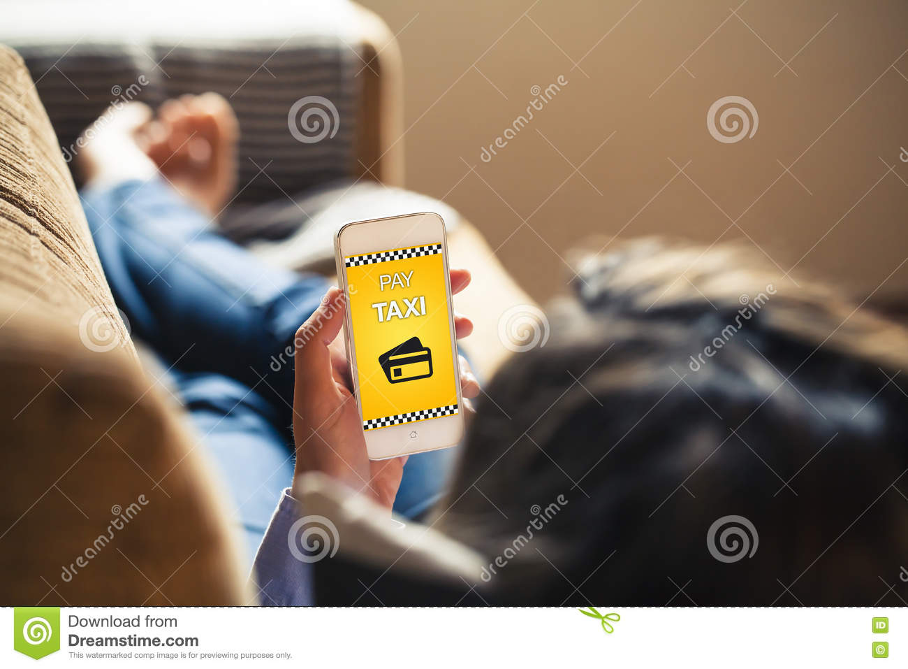 Sofa Taxi Woman Lying At Home Using A Mobile Phone To Pay A Taxi Stock