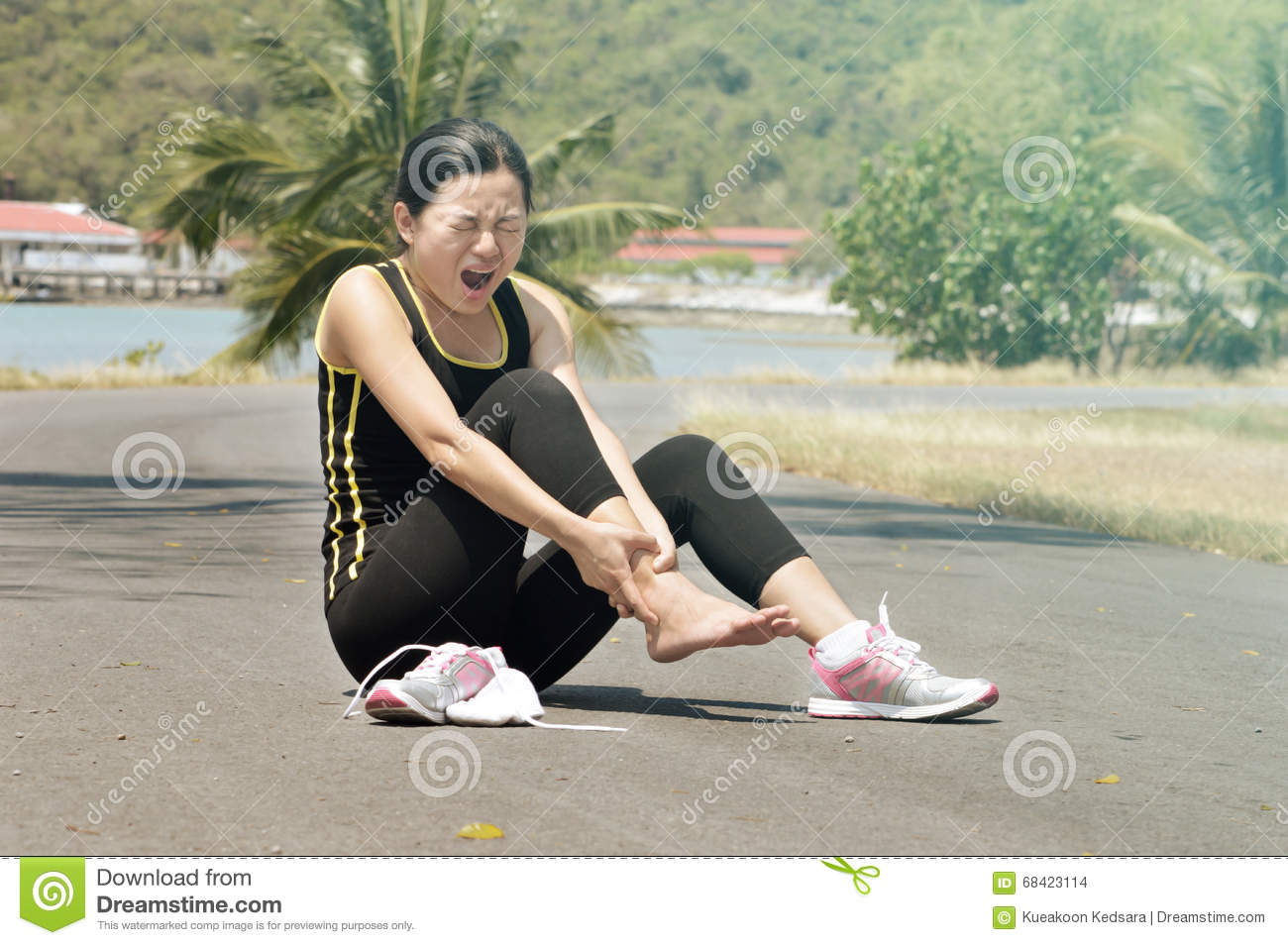 Running Jogging Music Download Woman With Pain In Ankle While Jogging Stock Photo Image