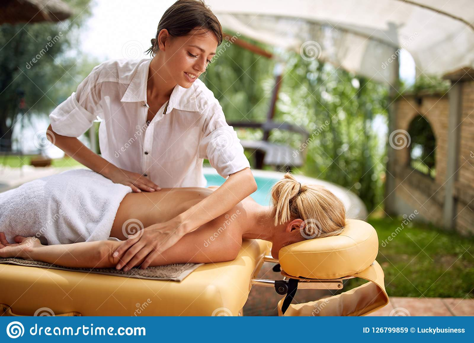 Where Can I Get Full Body Massage Woman Receiving Full Body Massage At The Spa Salon Profession Oc