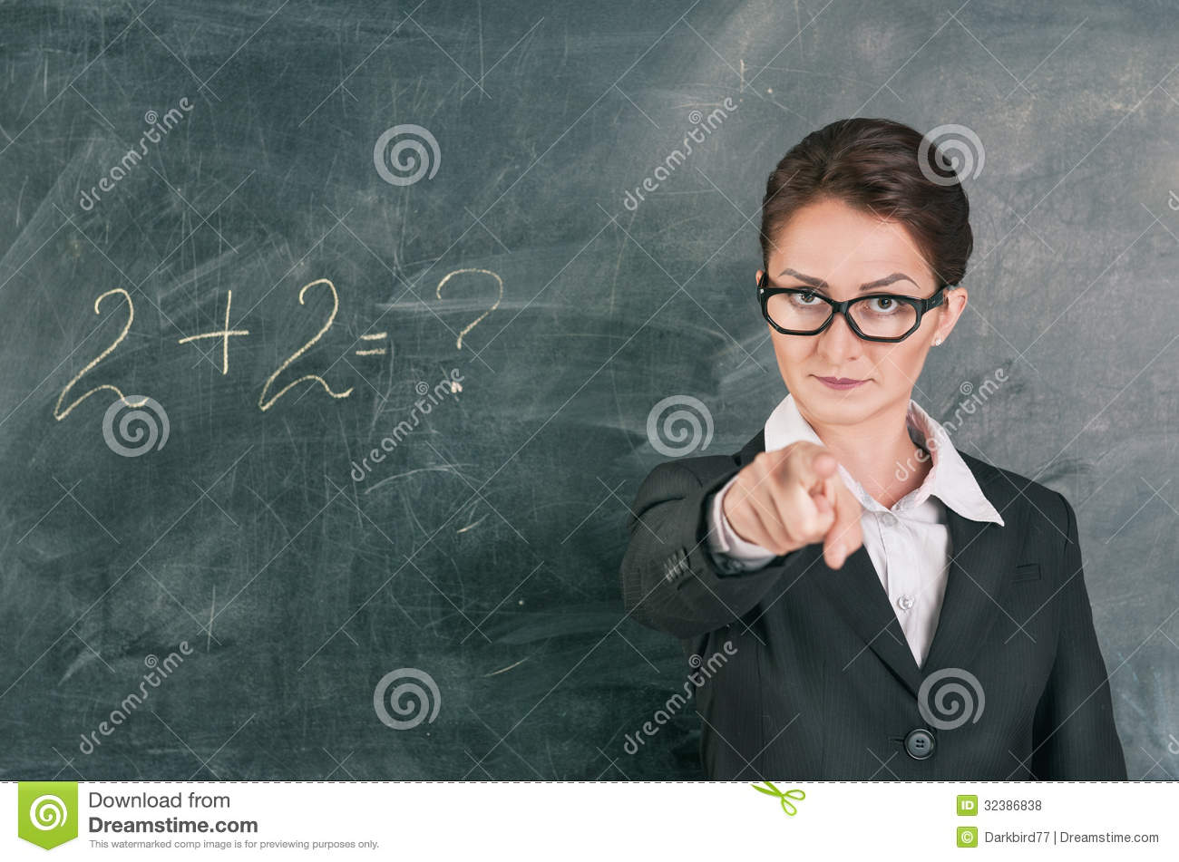 Teaching Maths Woman Teacher Teaching Maths And Pointing On Someone Stock Photo