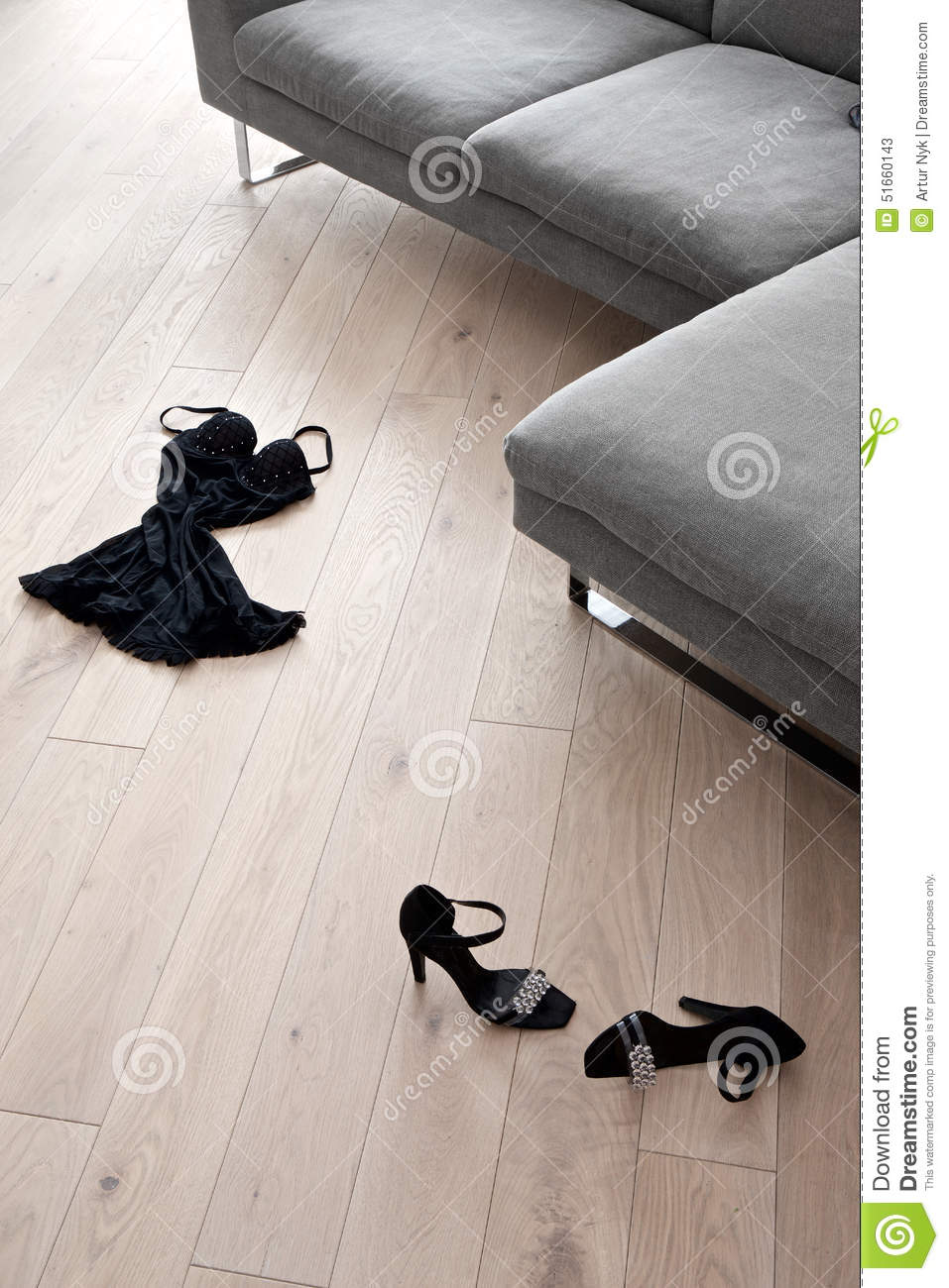 Lying On The Sofa Women's Shoes And Clothes Lying In Front Of A Sofa Stock