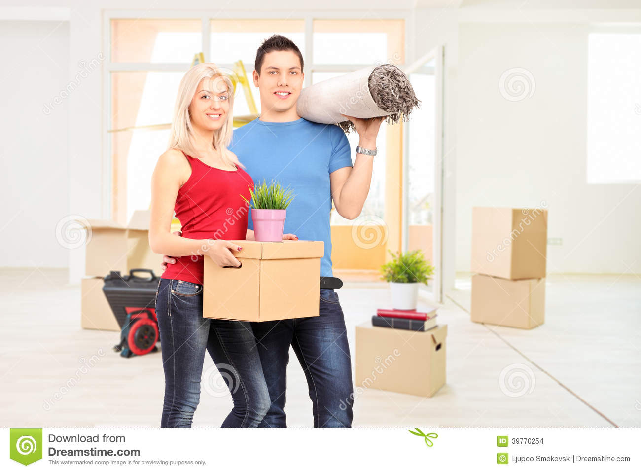 Young Couple Apartment Young Couple Moving Into A New Apartment Stock Photo