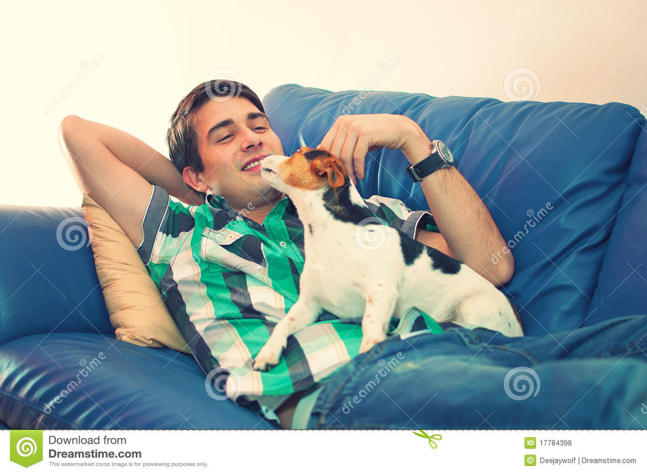 3 Person Couch Young Man And His Dog On A Couch Stock Photo - Image Of
