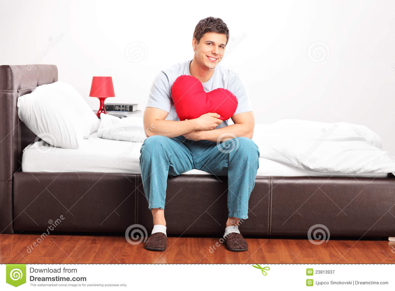 Pillow For Sitting Up In Bed Young Man Sitting On A Bed Royalty Free Stock Photography