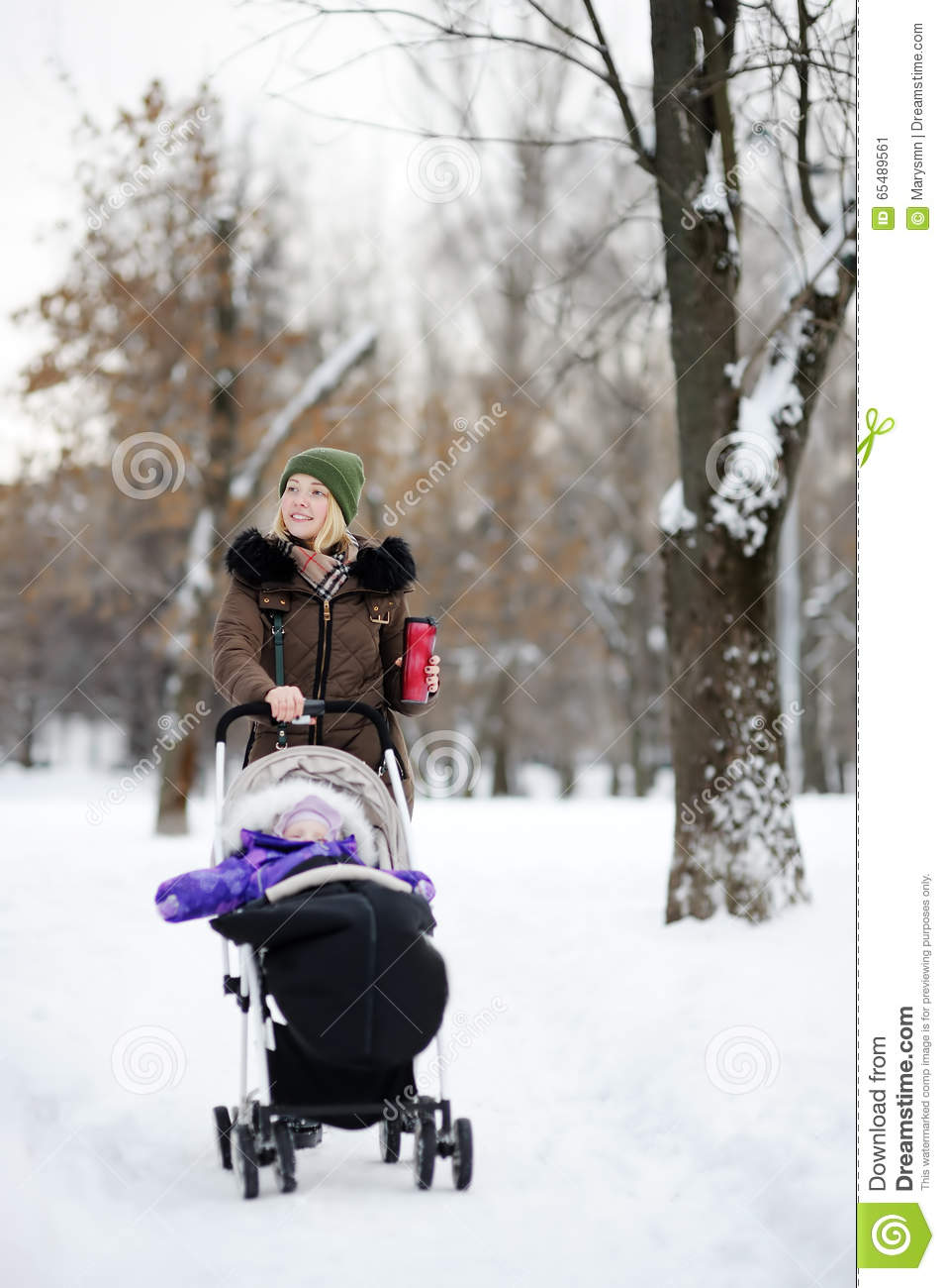 Childcare Pram Young Mother Walking With Baby In Stroller In Winter Park