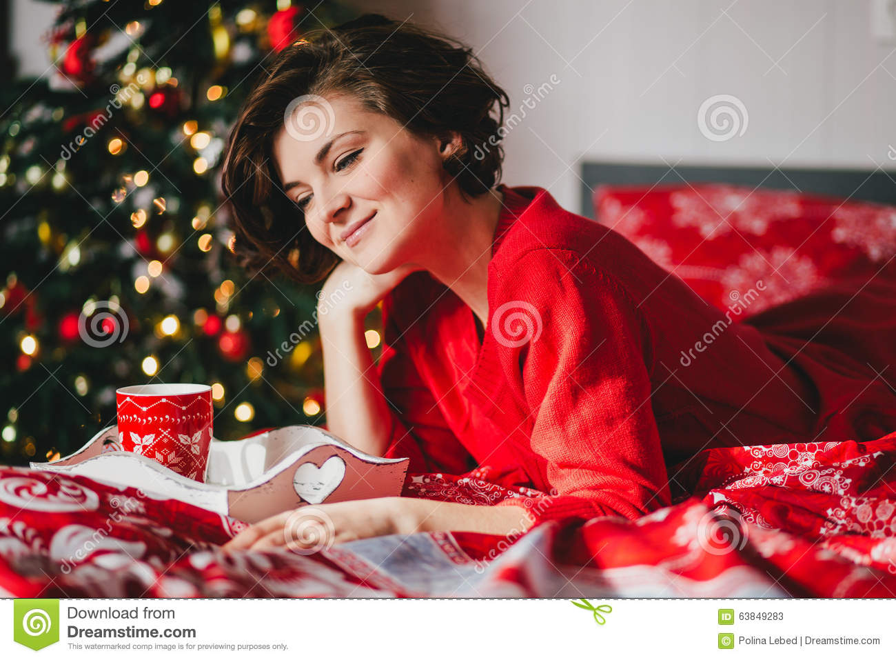 Christmas Bedroom Background Young Woman In A Red Knitted Dress Lying On The Bed In