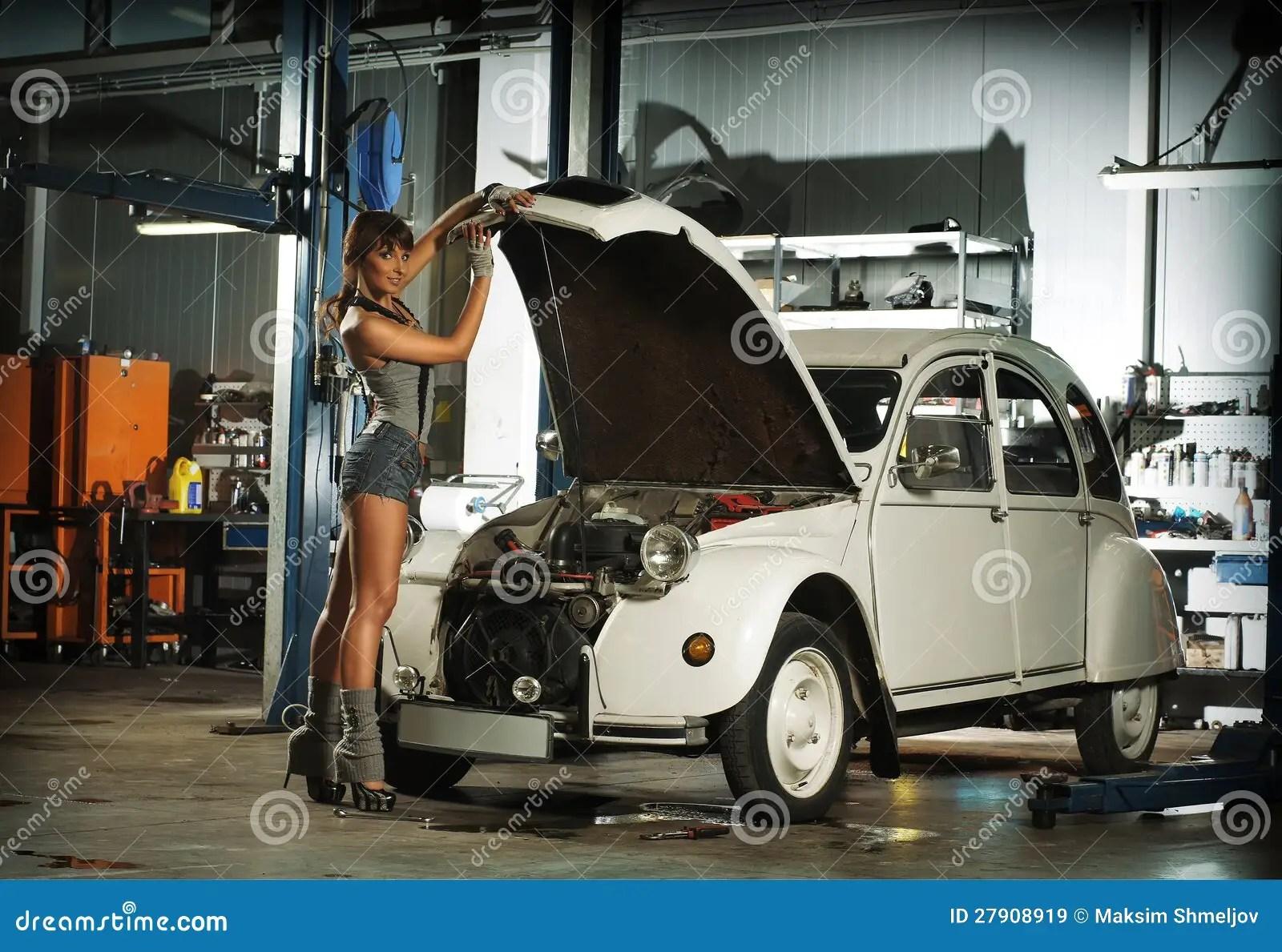 Free Wallpaper Cars And Beautiful Ladies Ferrari A Young Woman Repairing A Retro Car In A Garage Stock