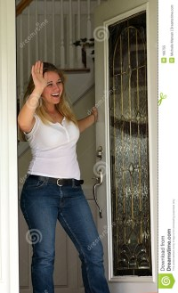 Young Woman Waving At Front Door Royalty Free Stock Photo ...