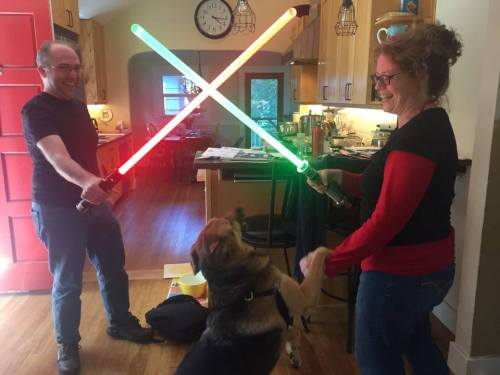 Michael Munz and Tiffany Pitts duel with light sabers as Thor Michaelson, Pawcifer of Justice, tries to break up the fight.