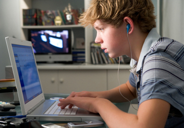A-teenage-boy-listens-to-music-360x250