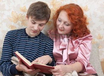 teen-son-with-mother-read-the-book