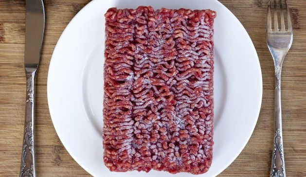 Table setting with frozen ground lean beef