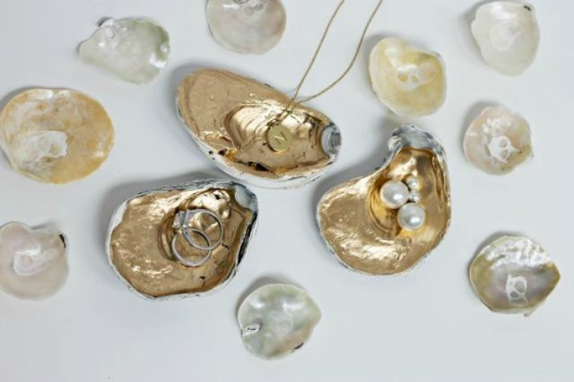 Gild inside of large oyster shells to hold jewelry