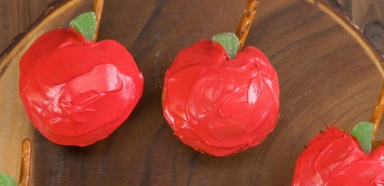Close-up of two cupcakes shaped and decorated like apples