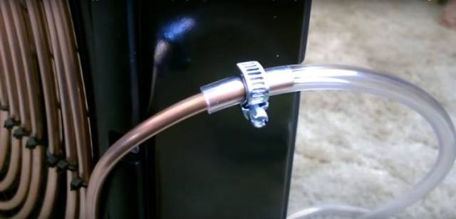 Connecting the plastic tube to the copper coil