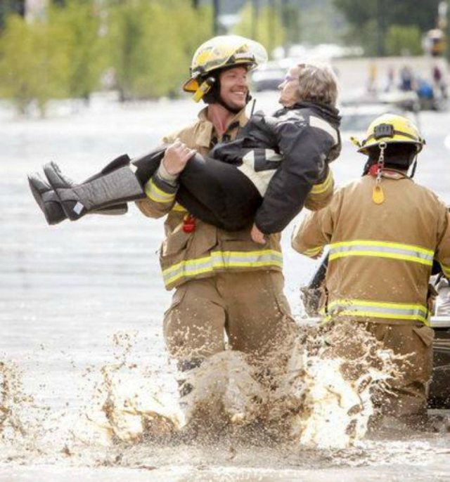 Full length picture of the fireman saving grandma.
