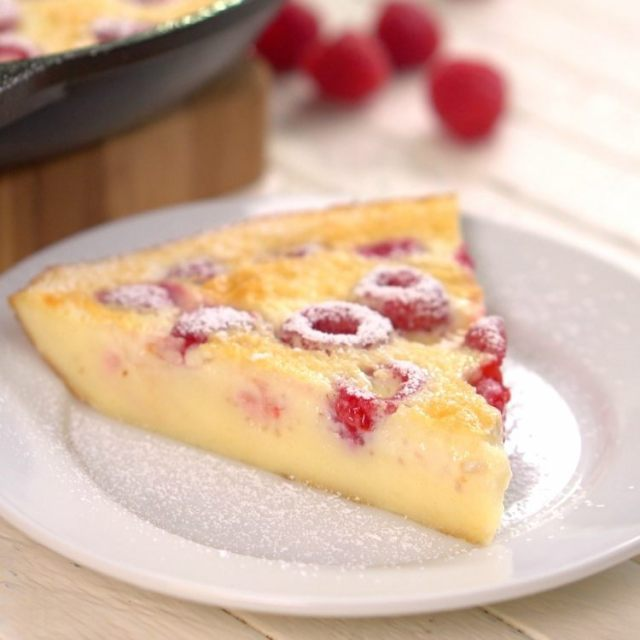 Slice of raspberries baked in custard called clafoutis