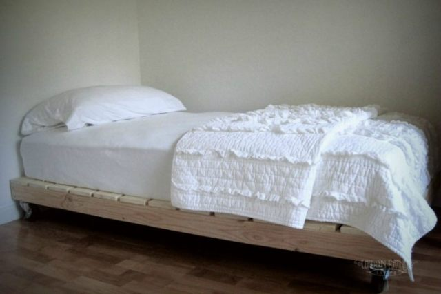 Bed on wheels made out of repurposed pallets