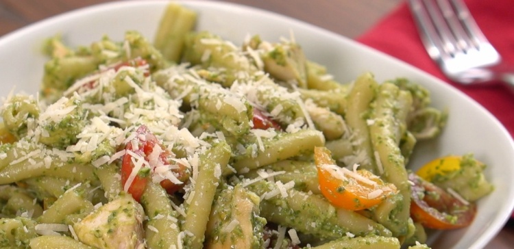 Close-up of white bowl of avocado pesto chicken pasta