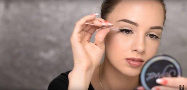 Applying false lashes correctly.