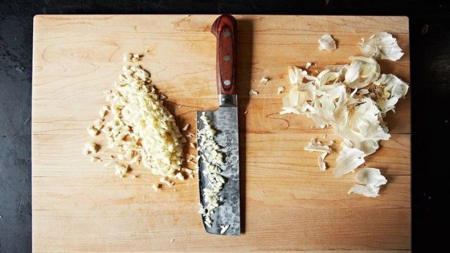knife minced garlic cutting board