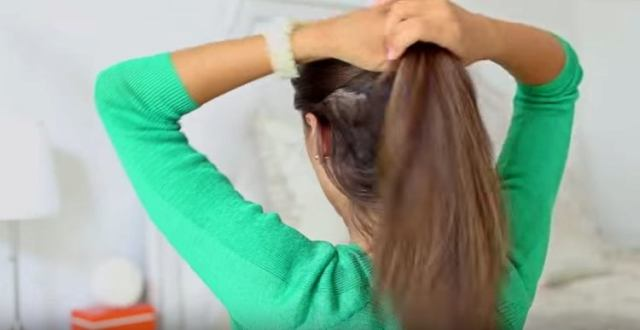 Take top half of hair and put into a ponytail