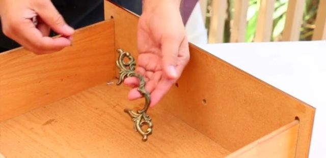 Unscrew the handles from the nightstand drawers