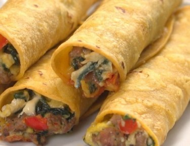 Close-up of sausage, egg and cheese breakfast taquitos