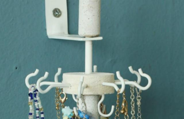 view of white jewelry organizer with hooks