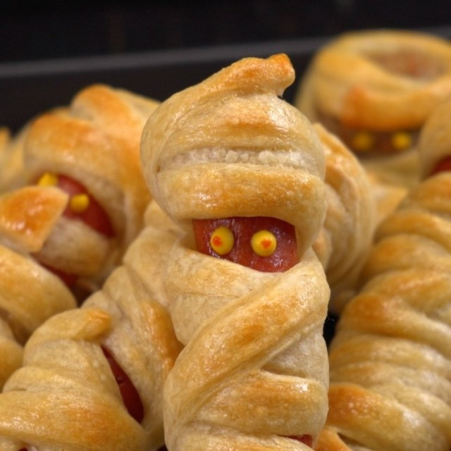 Hot dogs wrapped in dough and baked to look like mummies