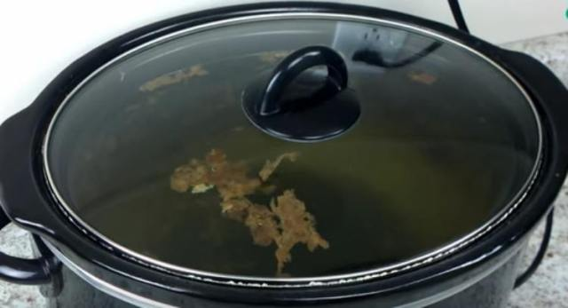 cooker with floating crud after night of cleaning