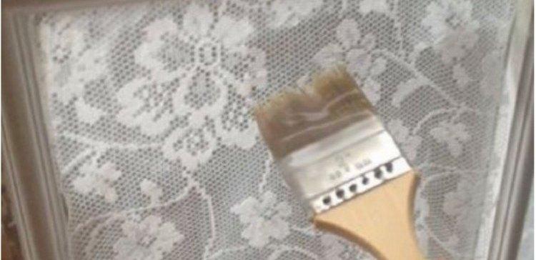 close up of paintbrush on lace window treatment