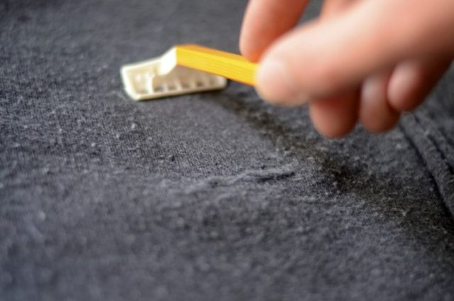 Use a razor to remove fabric pilling.