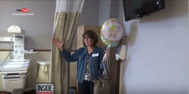 woman holding balloons walks into hospital room