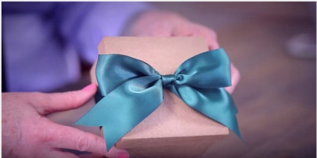 green satin bow on brown package