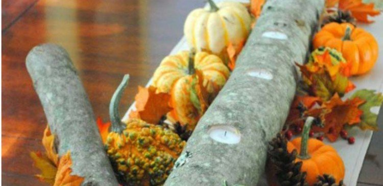 candle branch centerpiece surrounded by gourds