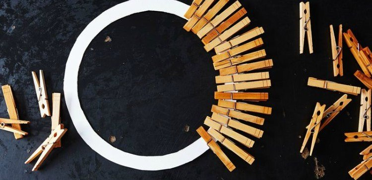 clothespins on circular piece of cardboard