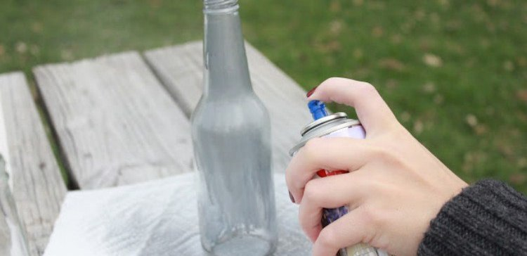 Image of bottle being spray painted.
