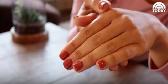woman showing off painted nails