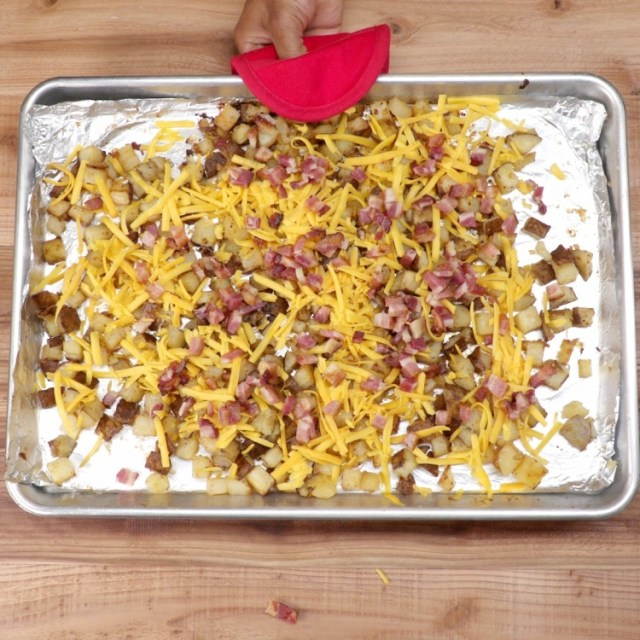 Sprinkle potatoes with shredded cheese and chopped bacon.Return the casserole dish or baking sheet to the oven and bake until the cheese has melted