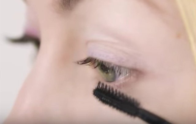 Coating lashes with DIY oil.