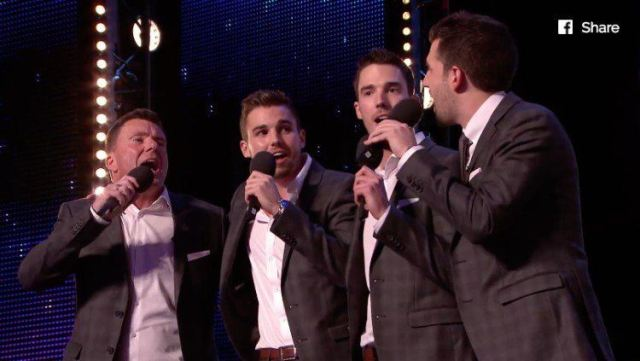 Four Neales men singing on stage.