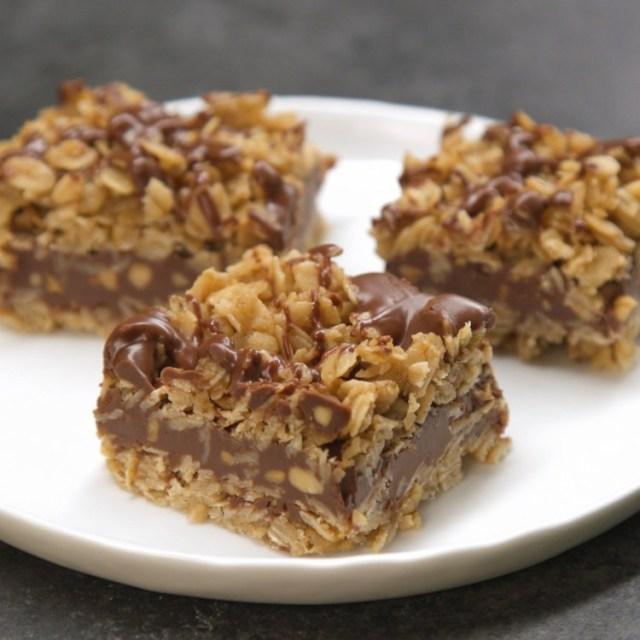 3 no-bake chocolate oat bars on white plate